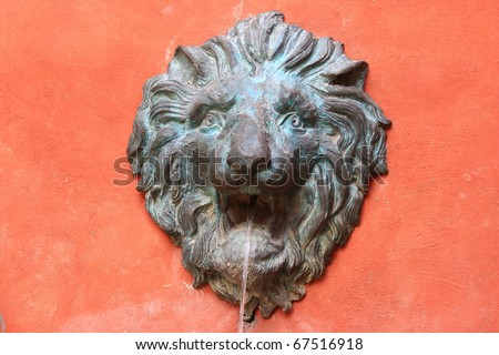 A ncient lion head water fountain