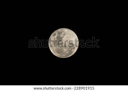 A near full moon is seen from the Southern Hemisphere. - stock photo