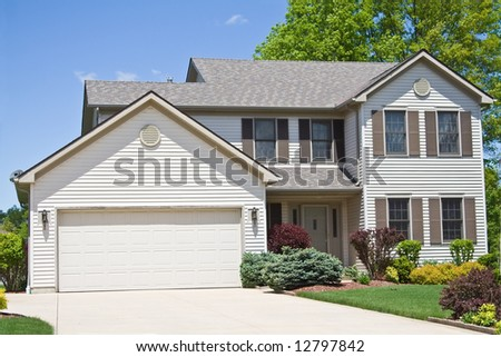 A neat American home in the suburbs of Cleveland, Ohio. - stock photo