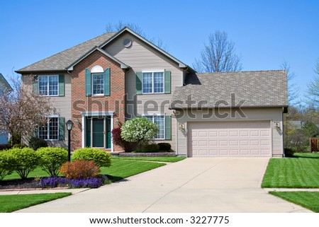 A neat home in the suburbs. - stock photo