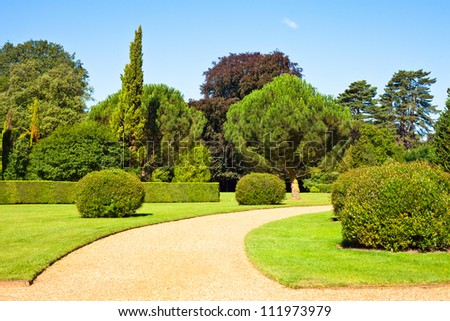 A neat path in an english summer garden on a summer day - stock photo
