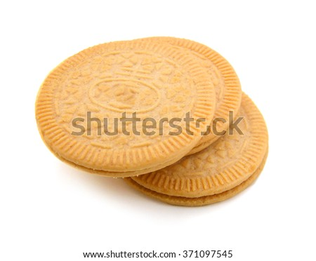 A neat stack of vanilla sandwich cookies