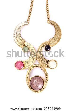a necklace with different colored beads on the end of the necklace. - stock photo