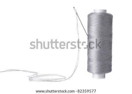 A needle in a spool of thread - stock photo