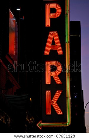 A neon parking sign at night in Manhattan. - stock photo