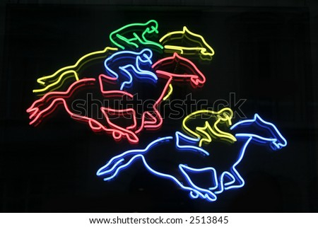 a neon sign for horse racing in vienna, austria - stock photo