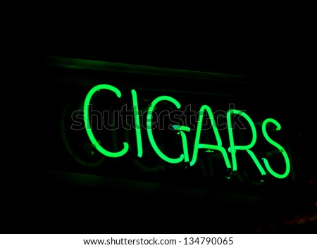 A neon sign promoting cigars - stock photo