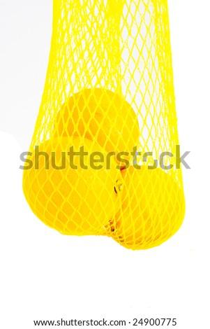 A net of lemons isolated on white - stock photo