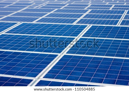 A never ending array of renewable energy solar panels. A background with plenty of copyspace.