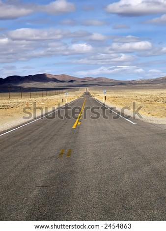 A never ending road in Nevada - stock photo
