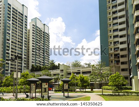 A new apartment neighborhood with carpark and playground. - stock photo