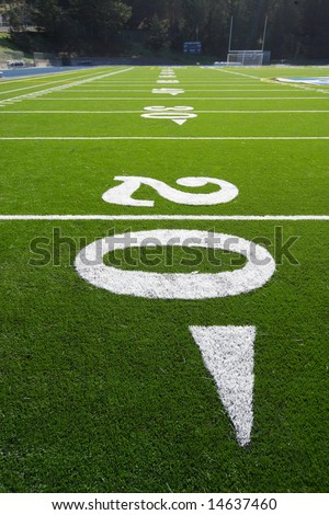 A new astro turf foot ball field - stock photo