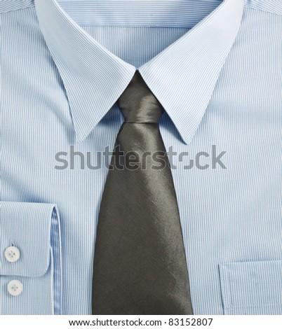 A new blue shirt with necktie, studio shot - stock photo