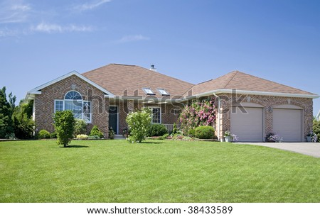 A new brick home in a subdivision. - stock photo