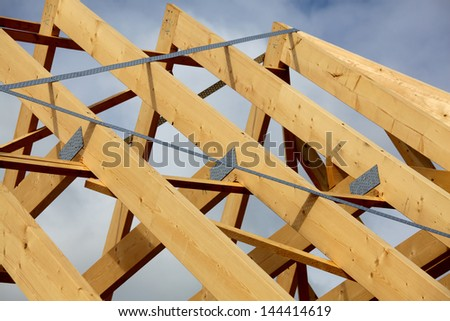 A new build roof with a wooden truss framework - stock photo