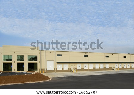 A new commercial warehouse for lease or sale - stock photo