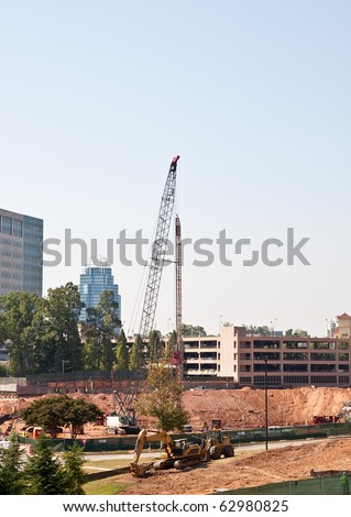 A new dig at construction site with heavy equipment and crane