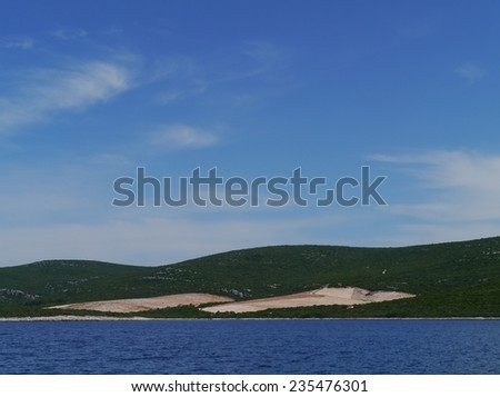 A new field for olive trees in an orchard on the island Pasman in the Adriatic sea of Croatia - stock photo