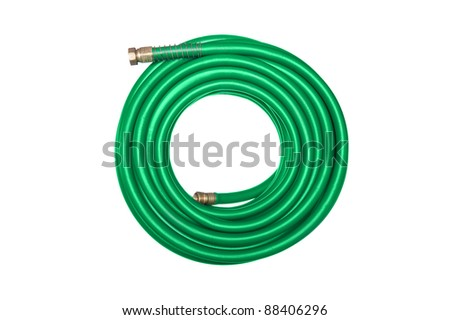 A new green coiled rubber hose isolated on white. - stock photo