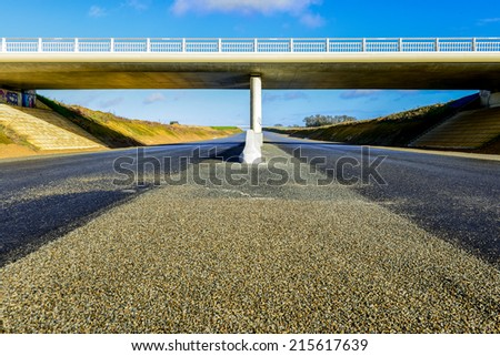 A new highway  under a modern new bridge - stock photo