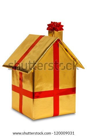 A new home wrapped in gold paper with red ribbon and bow, isolated on a white background. Good image for house buying or other property related themes. - stock photo