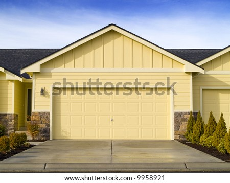 A new house for sale on a warm sunny day. - stock photo