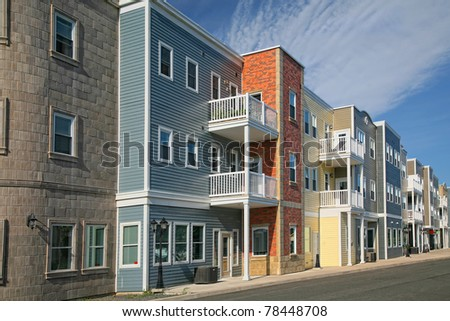 A new housing development containing either apartments or condos. - stock photo