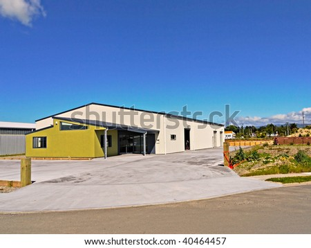 A new industrial building on a trading estate - stock photo