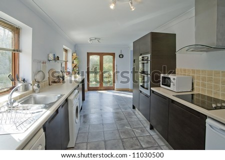 A new kitchen in a newly converted house - stock photo