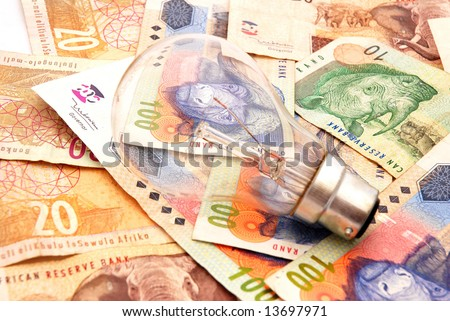 A new light bulb on South African money background - stock photo