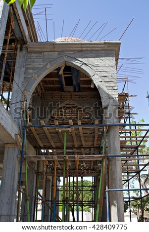 A new Mosque under construction in a Turkish town - stock photo