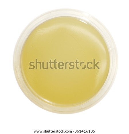A new petri dish with amber media for creating bacterial cultures. - stock photo