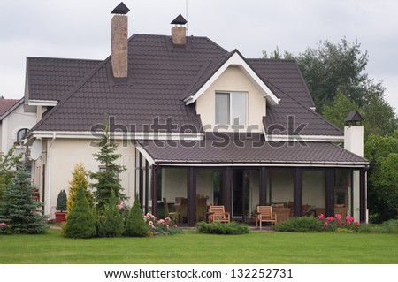 A new private house with a garden in a rural area - stock photo