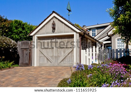A new residential single-car garage with classic Z-brace sectional door. - stock photo