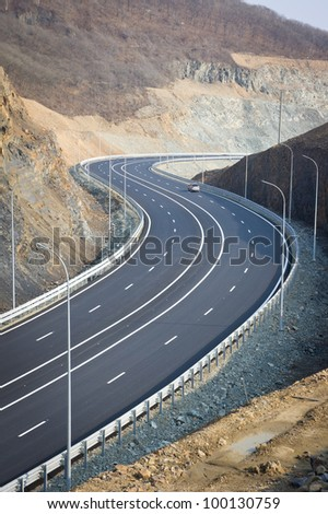 A new road between the mountains - stock photo
