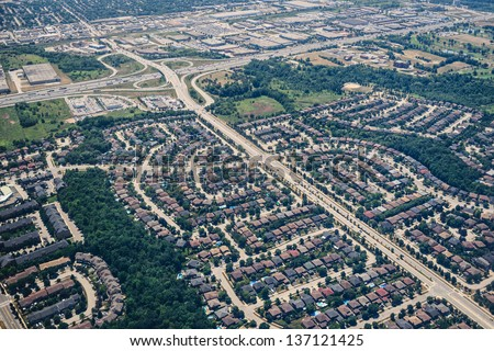 A new subdivision brushing up against nature. - stock photo