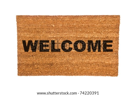 A new welcome doormat isolated on a white background. - stock photo
