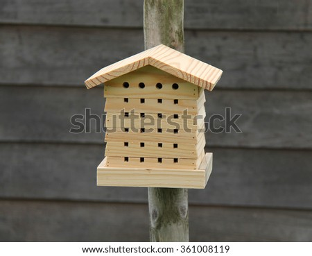 A New Wooden Insect House Fitted to a Post.