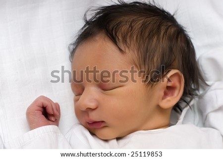 A newborn baby peacefully sleeping - stock photo