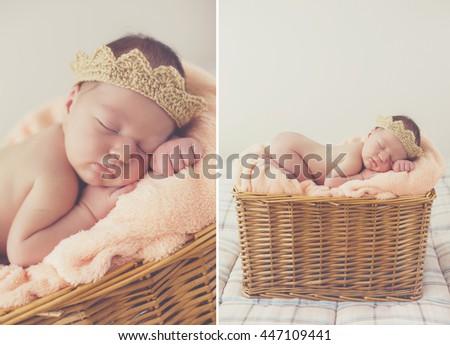 A newborn premature baby boy sleeping in a basket wearing a hat. Cute happy newborn baby in a blue knit cap sleeping in a basket. little newborn baby boy or girl - stock photo