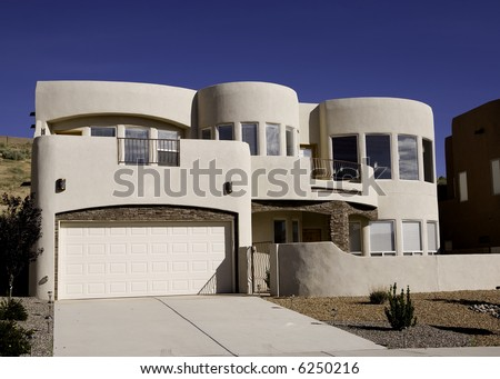A newer adobe home in New Mexico. - stock photo