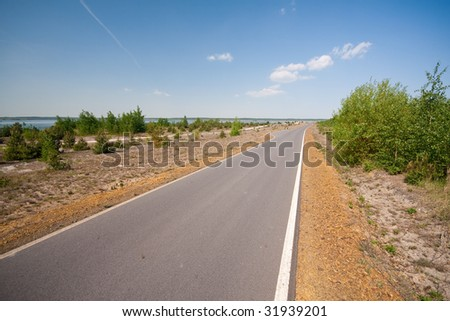 a newly build paved road - stock photo