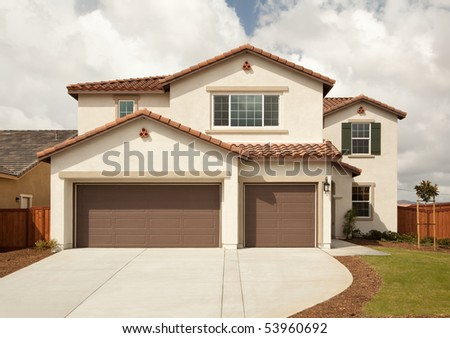 A newly constructed, modern american home. - stock photo