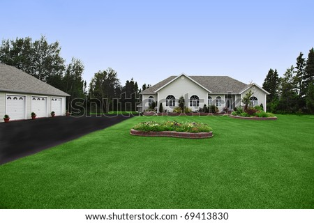 a newly constructed, modern rural home with big yard - stock photo