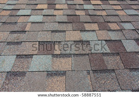 A newly installed composition asphalt shingle roof - stock photo