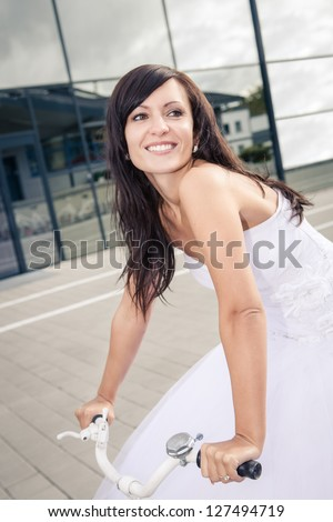 a newly married bride with golf accessories