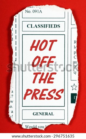 A newspaper clipping from the classified advertising section with the phrase Hot Off The Press in red text. Clipping created in MS Word by the photographer - stock photo