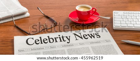 A newspaper on a wooden desk - Celebrity News - stock photo
