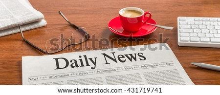 A newspaper on a wooden desk - Daily News - stock photo