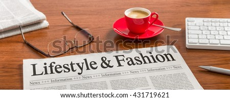 A newspaper on a wooden desk - Lifestyle and Fashion  - stock photo